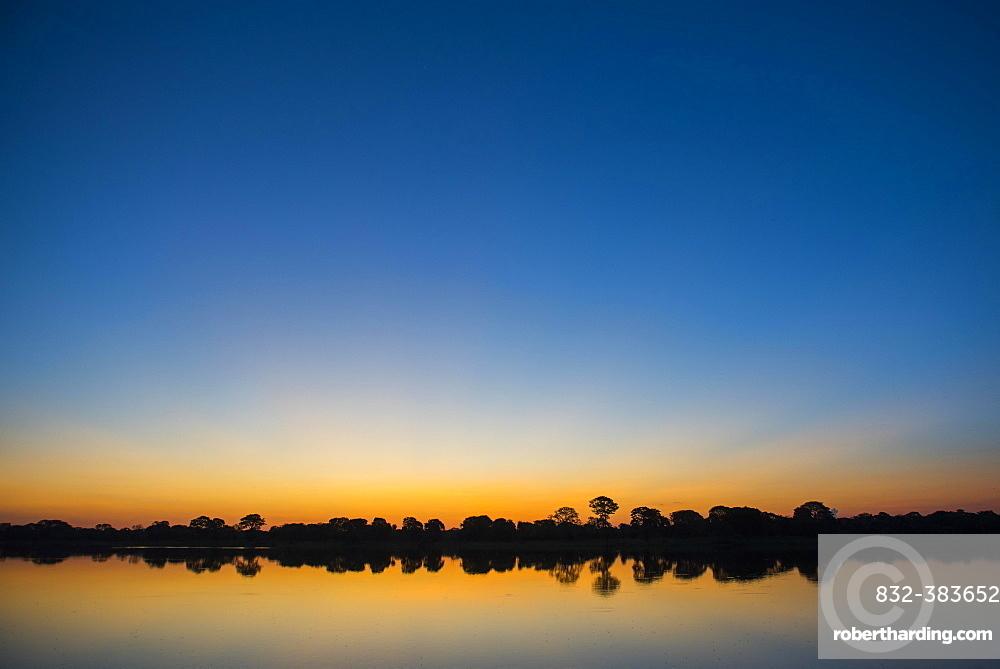 River landscape with Rio Negro at sunset, Fazenda Barranco Alto, Pantanal, Mato Grosso do Sul, Brazil, South America