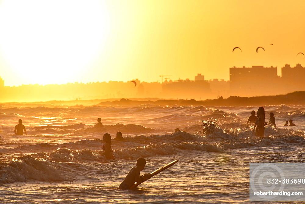 People bathing on the beach at sunset, beach Rambla, Montevideo, Uruguay, South America