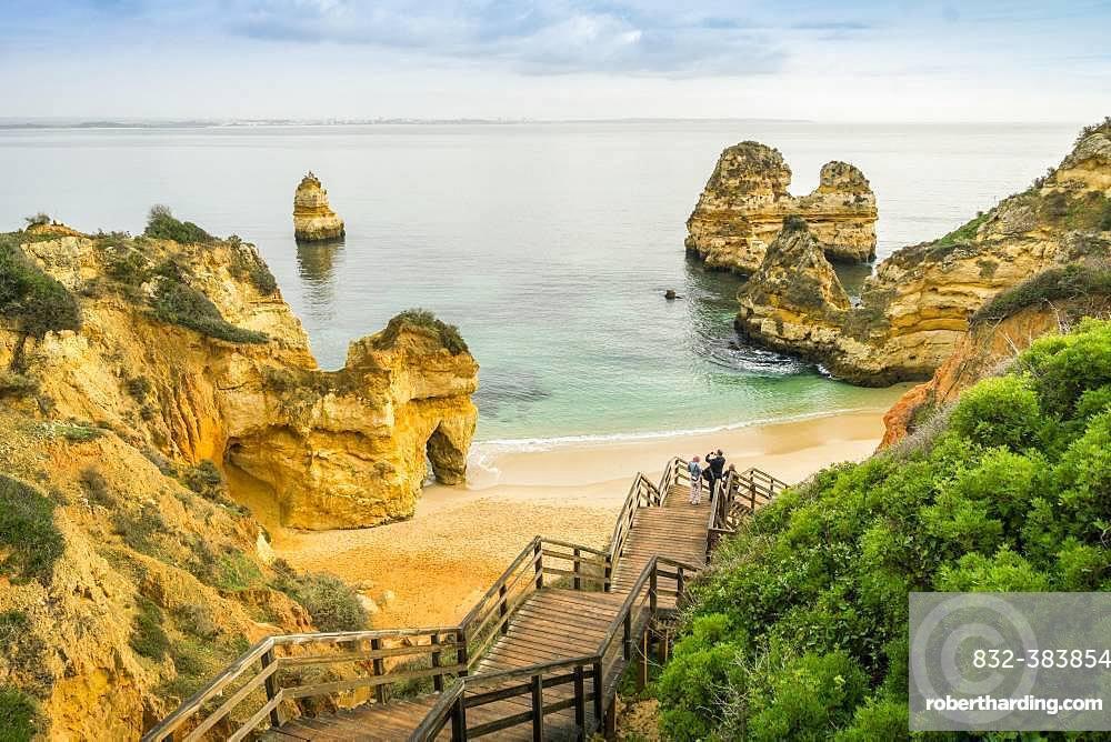 Camilo Beach with wooden walkway to the sandy beach, Lagos, Algarve, Portugal, Europe