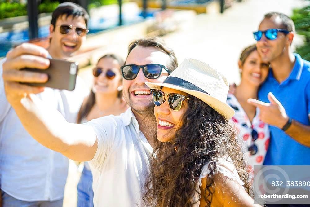 Two happy friends taking selfie in urban setting, Portugal, Europe