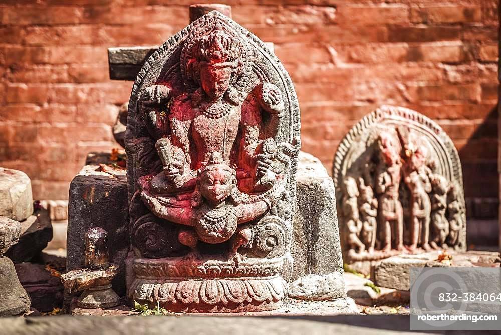 Hindu deity, ancient stone stele, Kathmandu, Himalayan region, Nepal, Asia