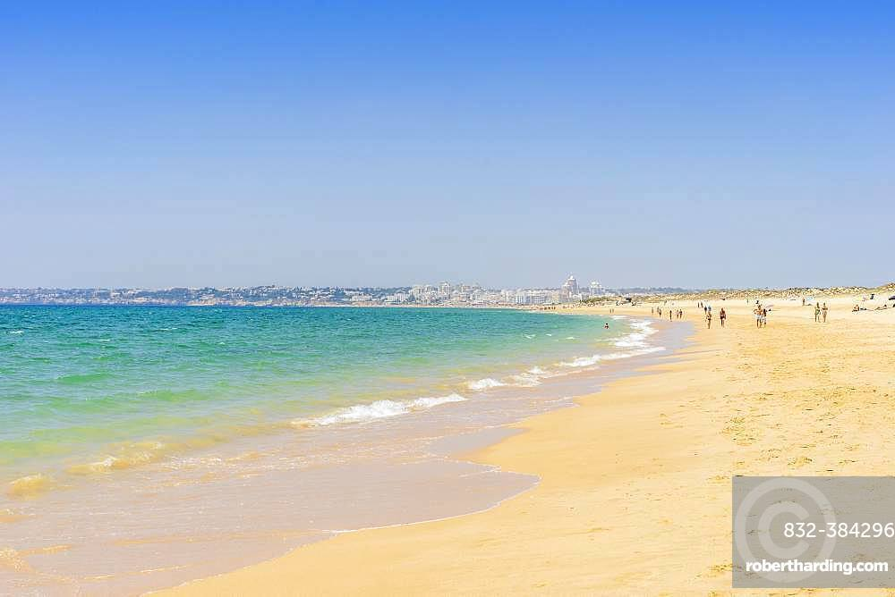 People relaxing on the beach next to Armacao de Pera, Algarve, Portugal, Europe