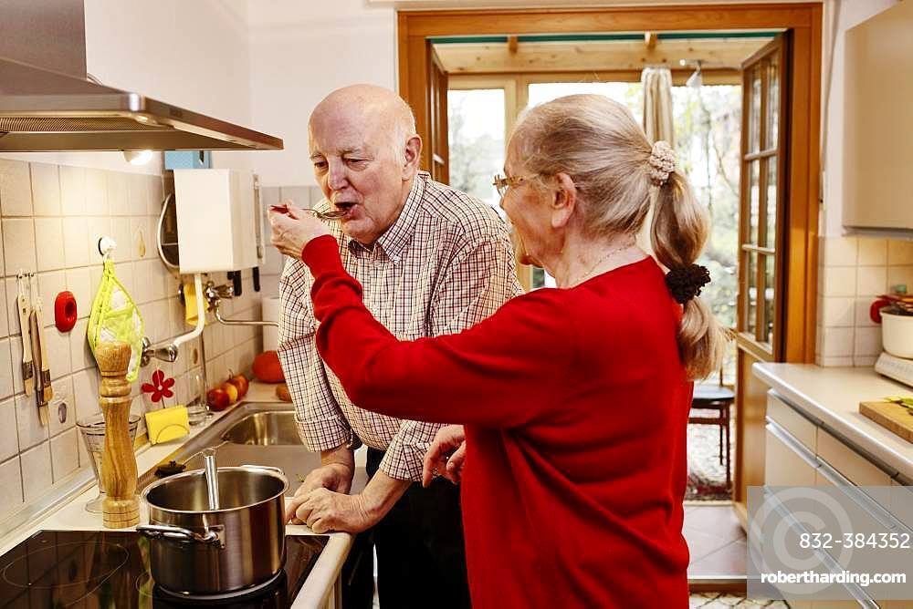 Senior woman lets her man try cooking, Germany, Europe
