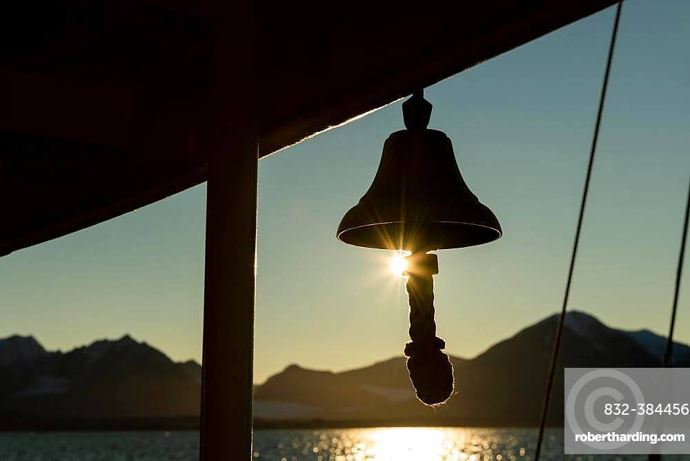 Ship's bell of a sailing ship, Silhouette in front of sun, Spitsbergen, Svalbard, Norway, Europe