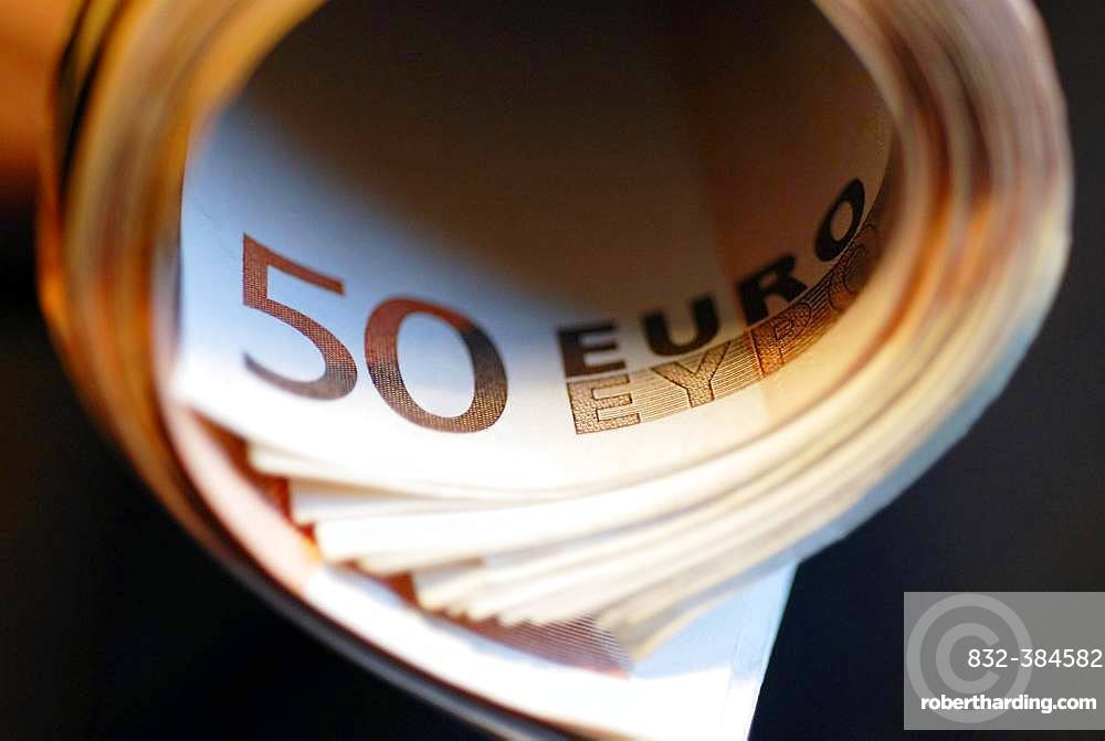 50 euro banknotes rolled, Germany, Europe