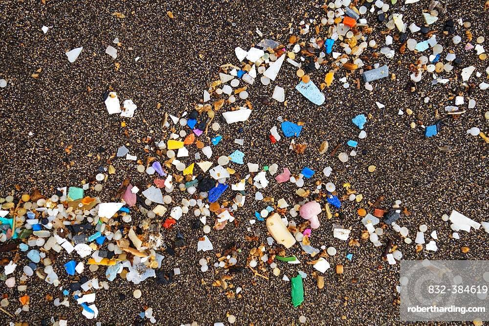 Microplastics on the sandy beach, washed up on dark lava sand, Playa Famara, Lanzarote, Canary Islands, Spain, Europe