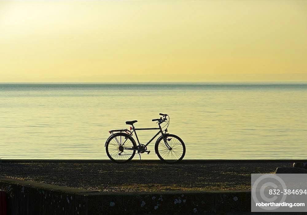 Silhouette, backlit bicycle, Lake Constance, Switzerland, Europe