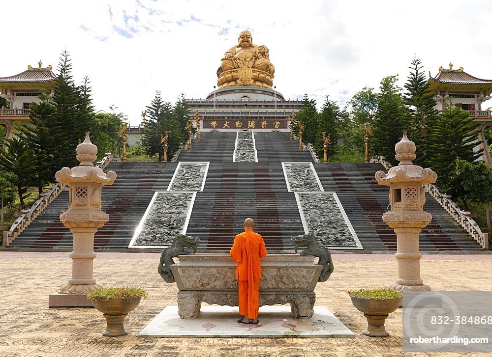 Happy Buddha, monk at an altar, Chiang Rai Province, Northern Thailand, Thailand, Asia