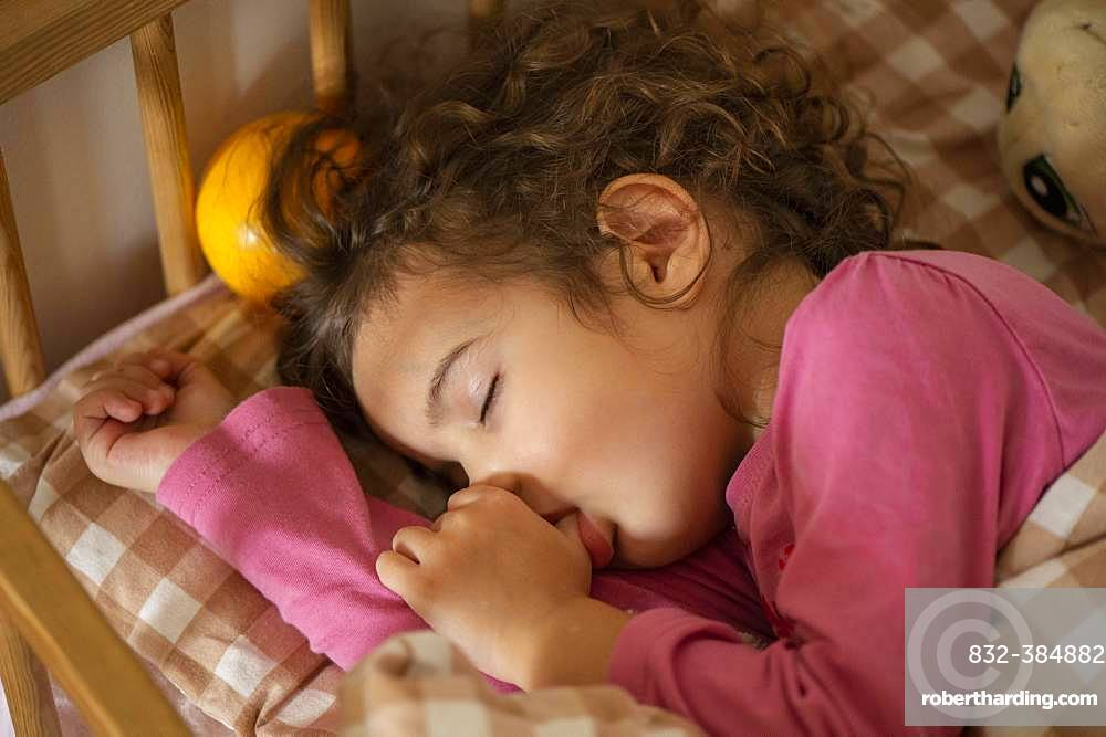Girl, 3 years, portrait, sleeps in bed, with thumb in mouth, Germany, Europe