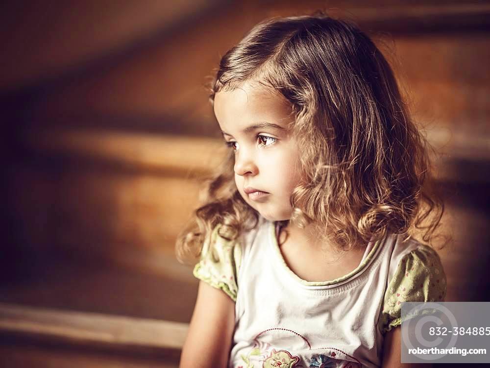Girl, 3 years, sitting on the stairs, melancholic gaze, Portrait, Germany, Europe
