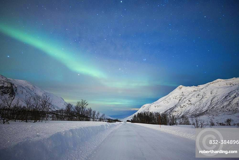 Northern lights at the snow-covered Kattfjordpass, Tromso, Norway, Europe