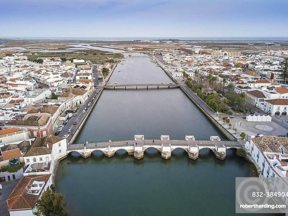 City view with roman bridge over Gilao river in old fishermen's town, Tavira, drone shot, Algarve, Portugal, Europe