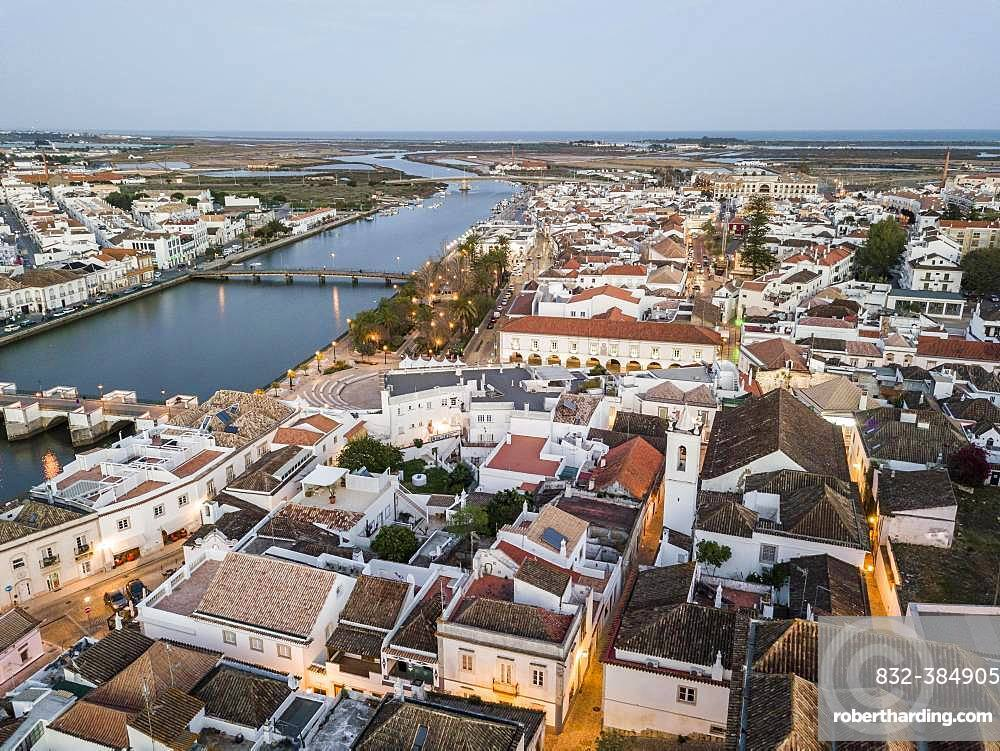 City view with roman bridge over Gilao river in old fishermen's town in the evening light, Tavira, drone shot, Algarve, Portugal, Europe