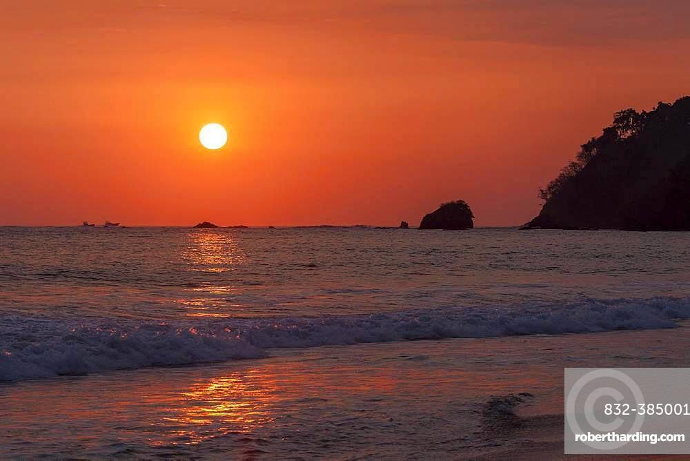 Red glowing sunset over the sea, evening sun, Playa Espadilla, Manuel Antionio National Park, Puntarenas Province, Costa Rica, Central America
