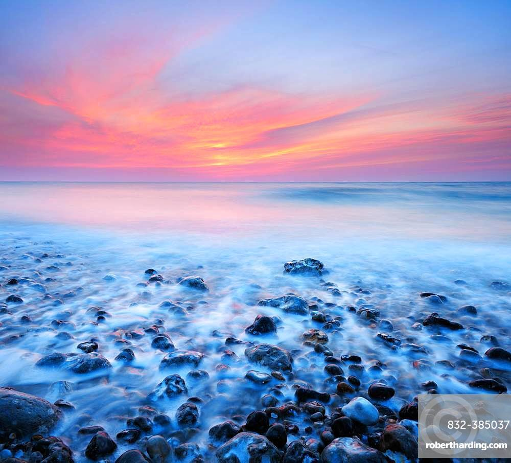 Sunset, sunset by the sea, stones in the surf, English Channel, Saint-Martin-aux-Buneaux, Normandy, France, Europe