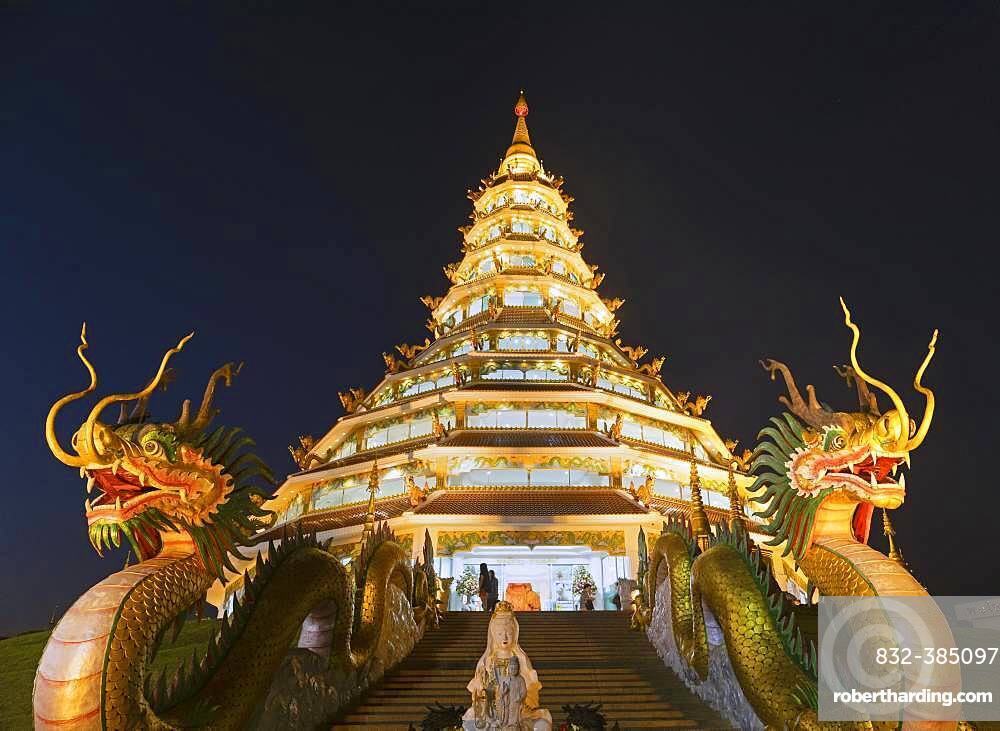 Nine-storey Chinese pagoda at dusk, dragons at the entrance to Wat Huay Pla Kang Temple, Kuan Yin, Chiang Rai, Northern Thailand, Thailand, Asia