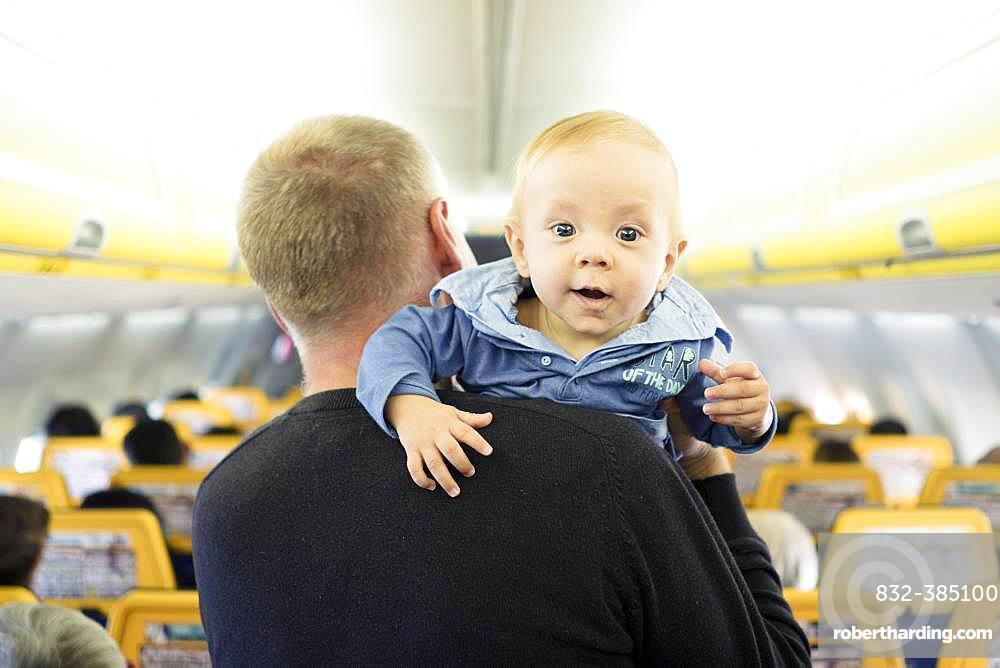 Father with his six months old baby boy in the airplane, Spain, Europe