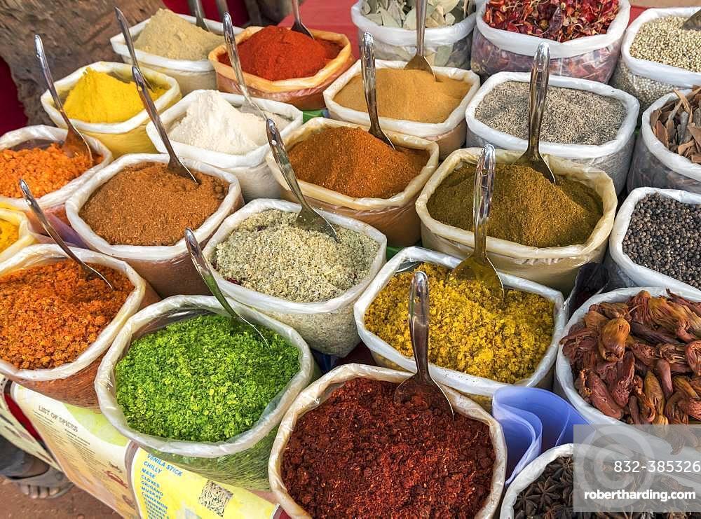 Sacks of spices, herbs and curry powders on display at Anjuna Beach Flea Market, Goa, India, Asia