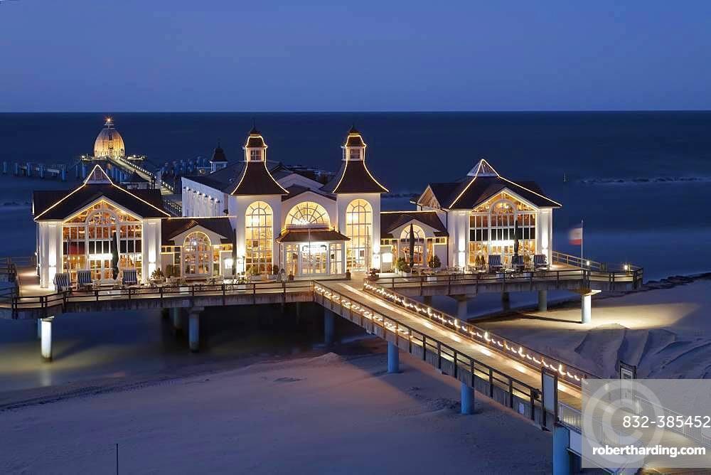 Illuminated pier at the Baltic Sea in evening mood, Sellin, Ruegen, Mecklenburg-Western Pomerania, Germany, Europe