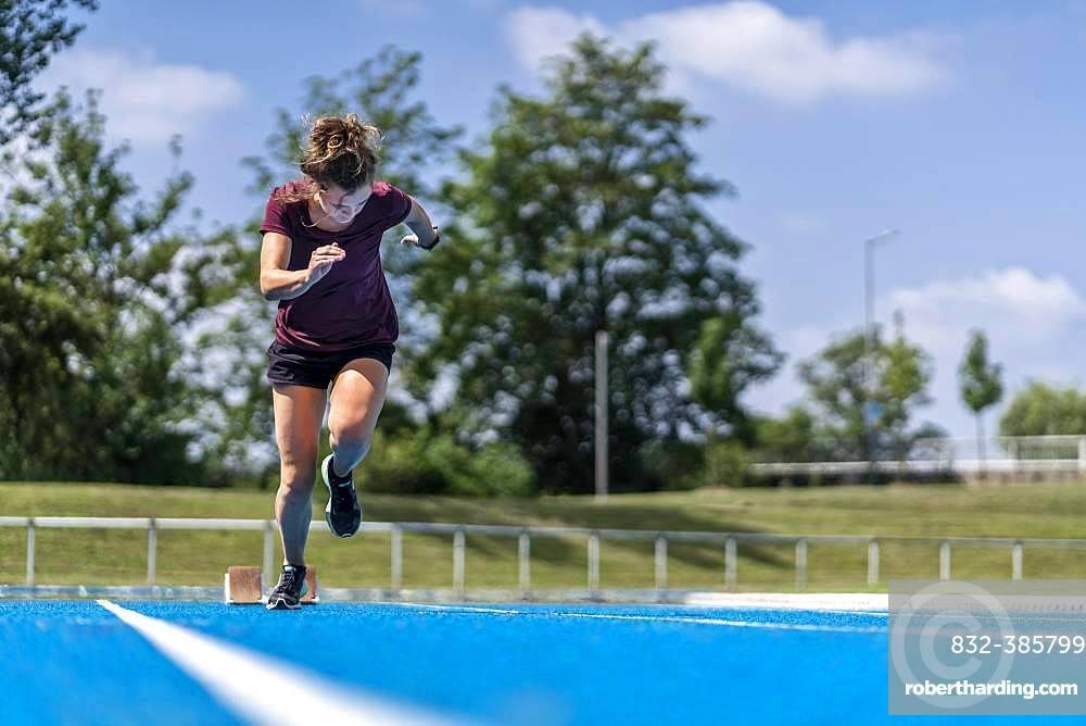Athletics, woman sprinting, start from start block, Germany, Europe