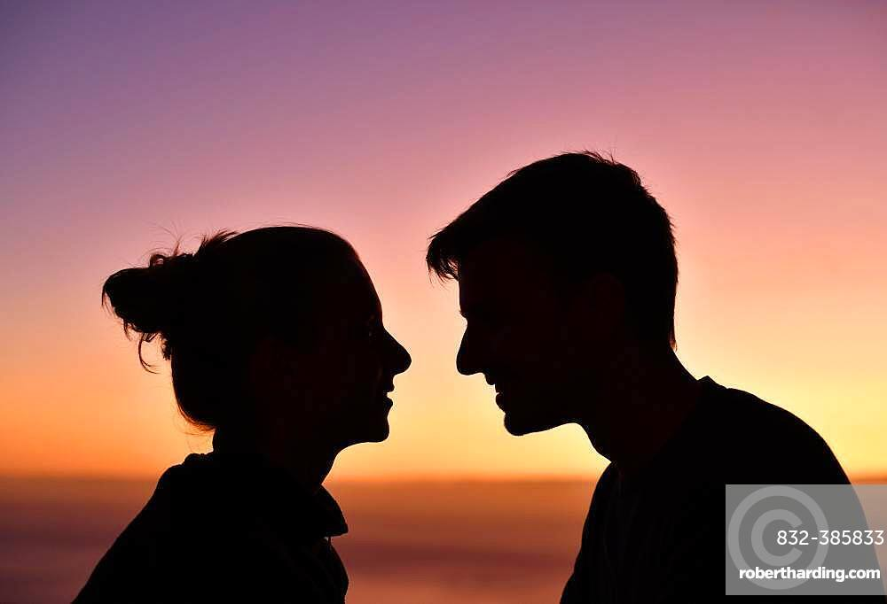 Young couple, lovers, silhouette, face-to-face, at sunset, Madeira Island, Portugal, Europe