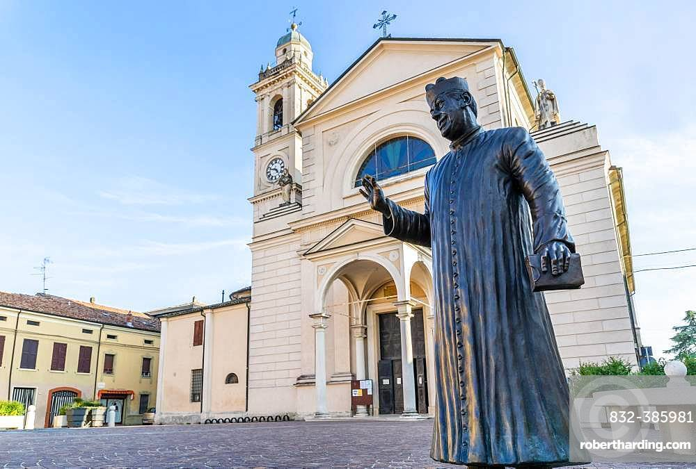 Statue of Don Camillo in Piazza Giacomo Matteotti in front of the Church of Santa Maria Nascente, location of the films of Don Camillo and Peppone, Brescello, Province of Reggio Emilia, Emilia-Romagna, Italy, Europe