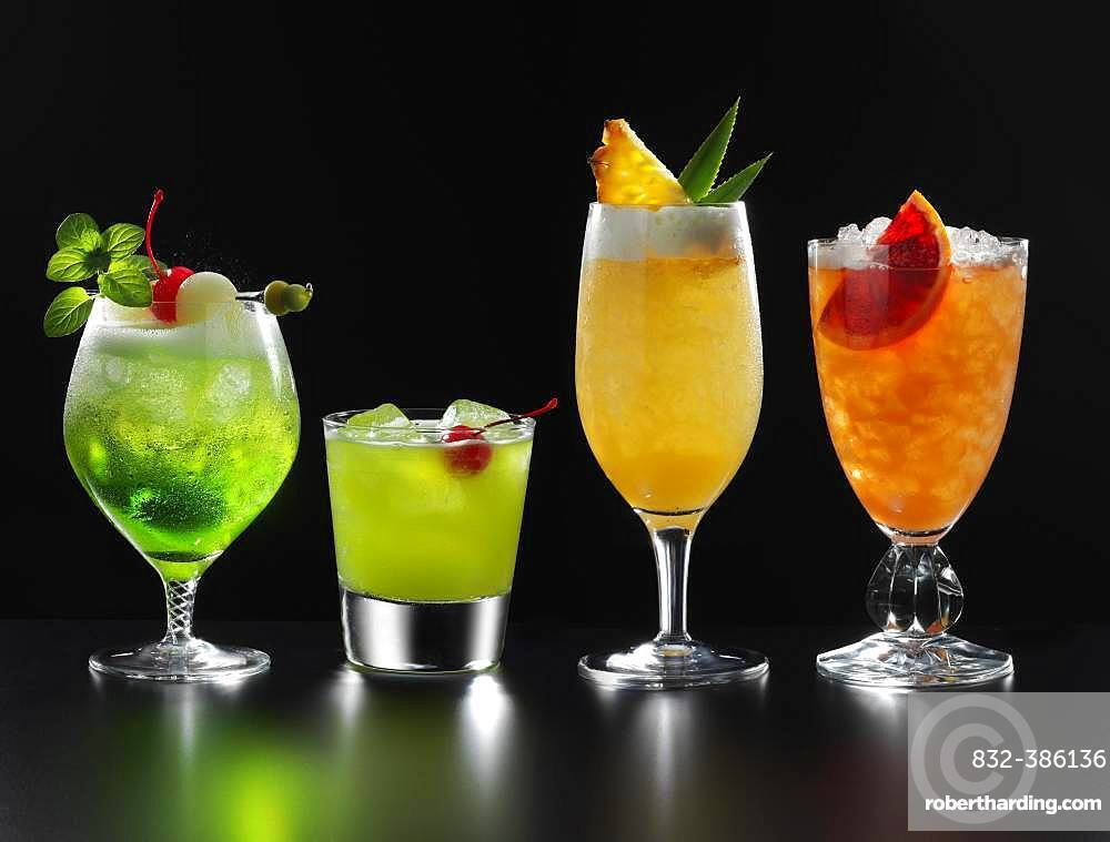 Four different fruity cocktails, black background, Germany, Europe