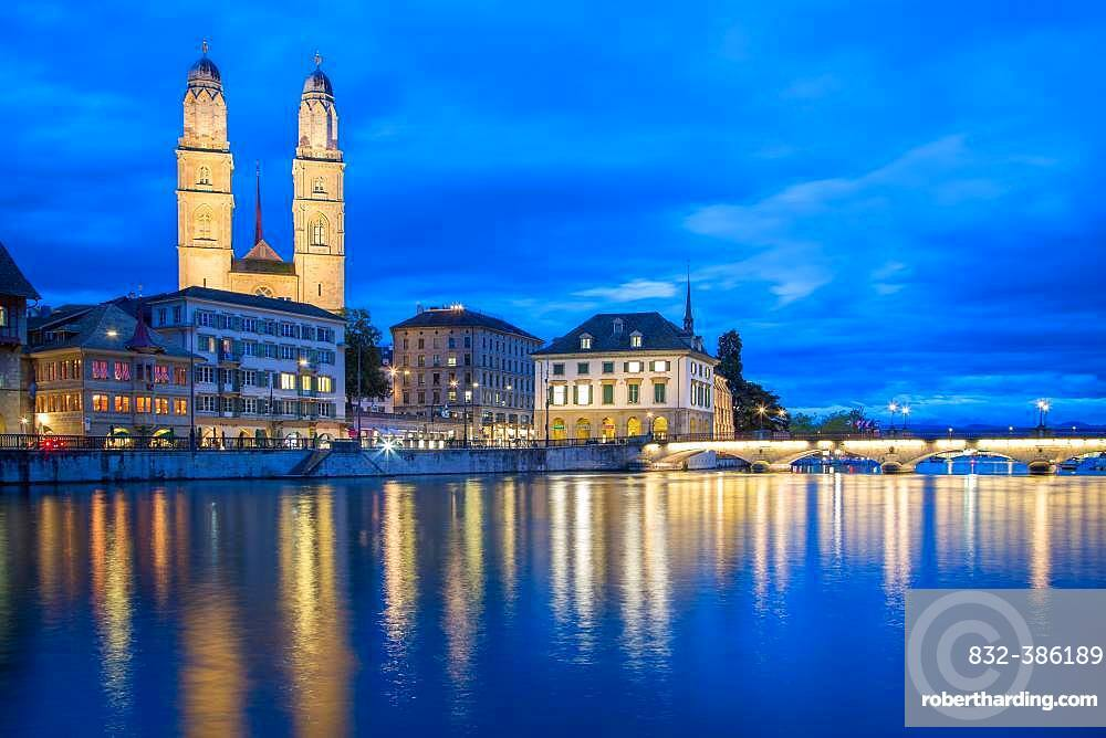 View over the river Limmat at dusk, church Grossmuenster and Lake Zurich in the background, old town, Zurich, Switzerland, Europe