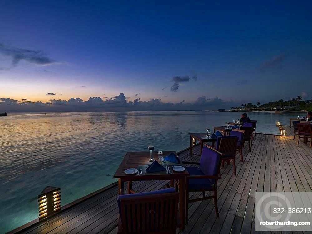 Sunset on the beach with restaurant on Maldives island South Male Atoll, Maldives, Asia