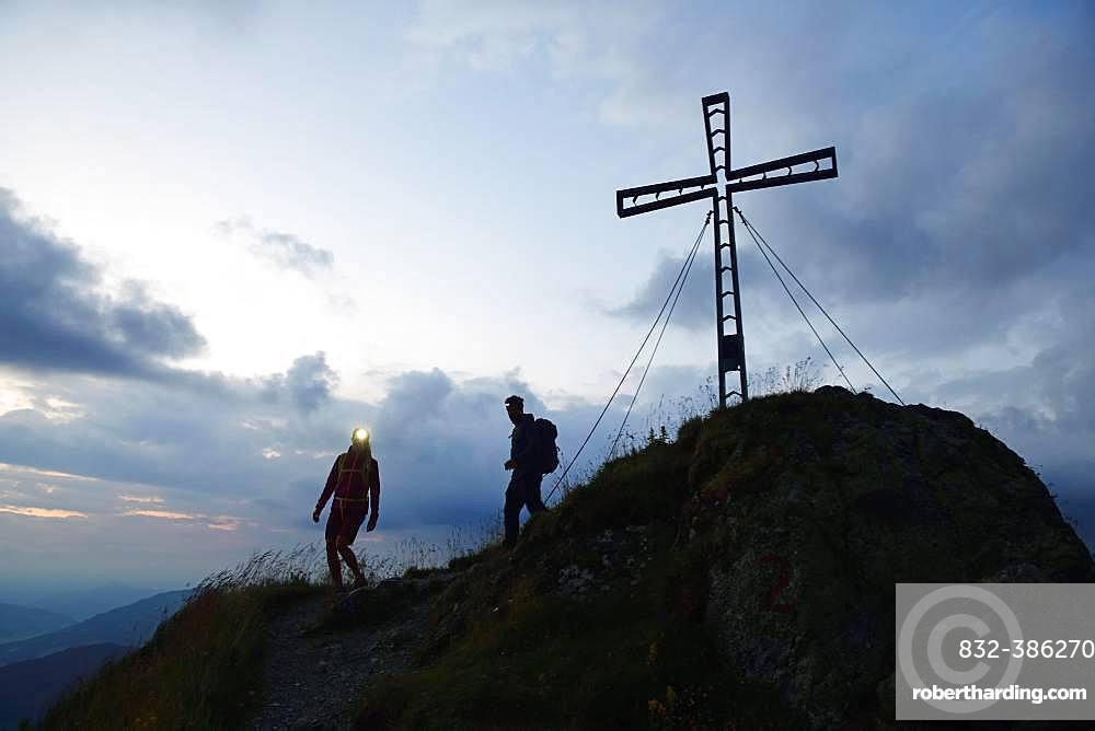 Hikers at dawn on the summit of the Feldalphorn, Kelchsau, Kitzbuehel Alps, Tyrol, Austria, Europe