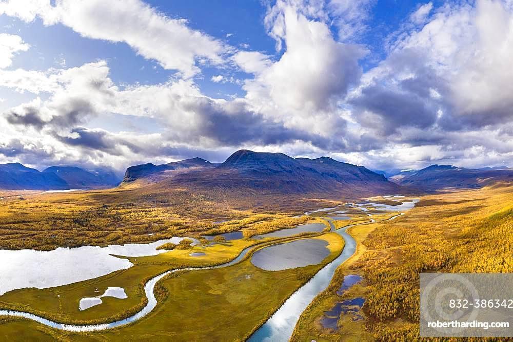 Autumn landscape with river, lakes and mountains, river Visttasjohka, Nikkaluokta, Lapland, Sweden, Europe