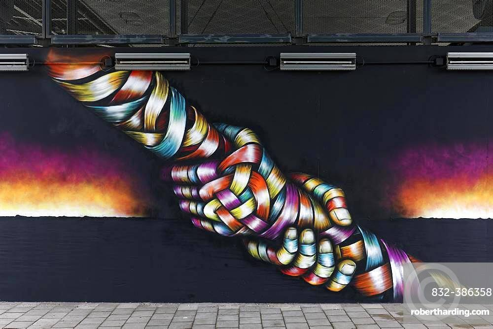 Two hands grab each other by the arm, pulling in the opposite direction, symbolic mural by streetart artist Otto Schade, 40 Grad Urban Art Festival 2019, Duesseldorf, North Rhine-Westphalia, Germany, Europe