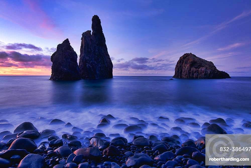 Volcanic rock formation Ilheus da Rib, steep coast of Ribeira de Janela, also Ribeira da Janela, blue hour, sunset, Porto Moniz, island Madeira, Portugal, Europe