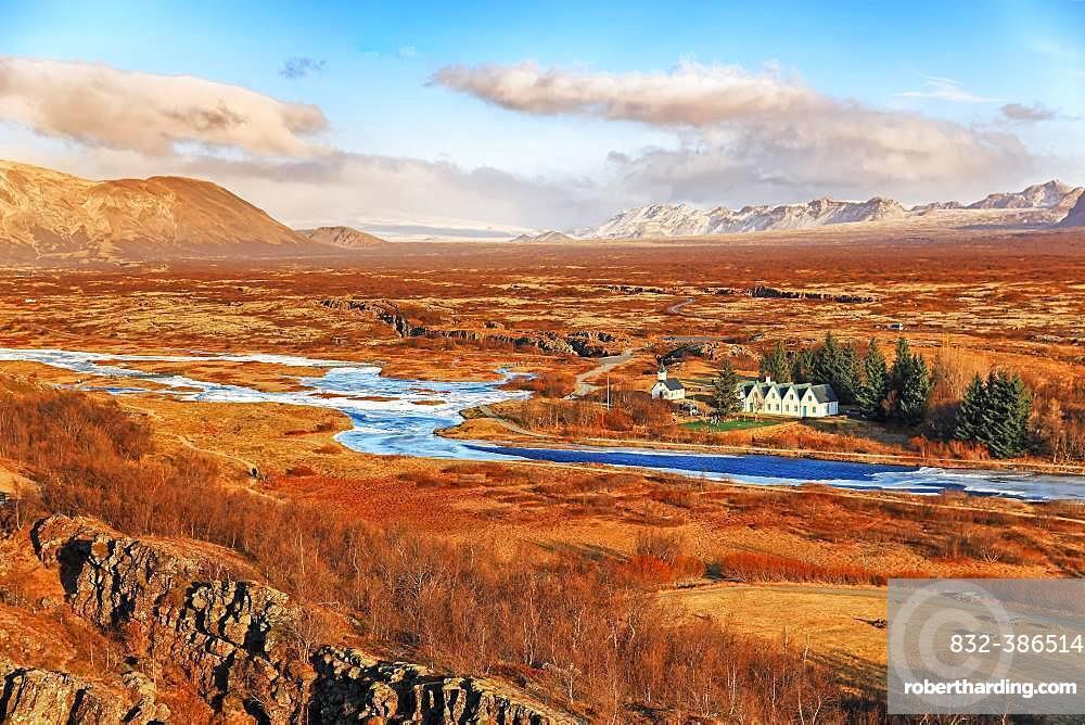 Pingvellir, Thingvellir National Park, church and five-gable house by the river, sunny autumn day, Golden Circle, Iceland, Europe