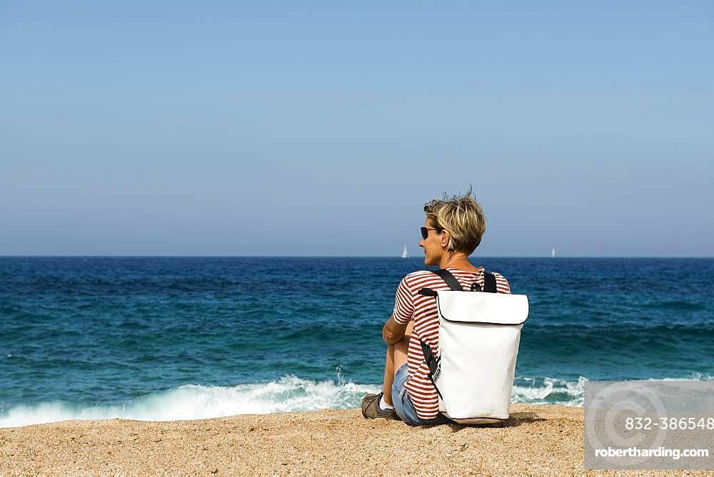 Woman on a beach, near Sartene, Corsica, France, Europe