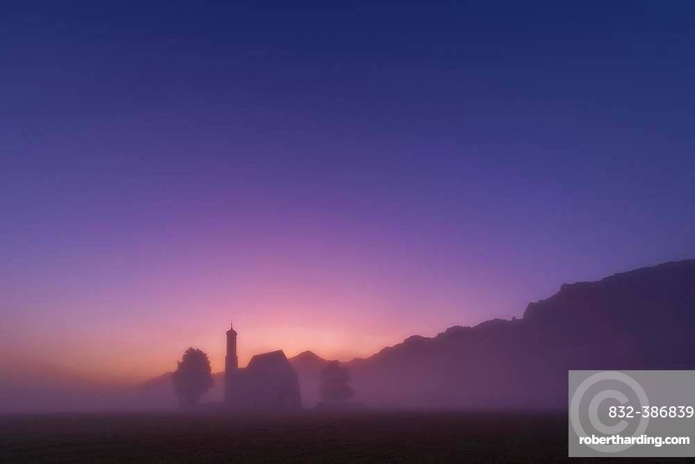 Chapel St. Coloman at blue hour in the fog, Fuessen, Swabia, Bavaria, Germany, Europe