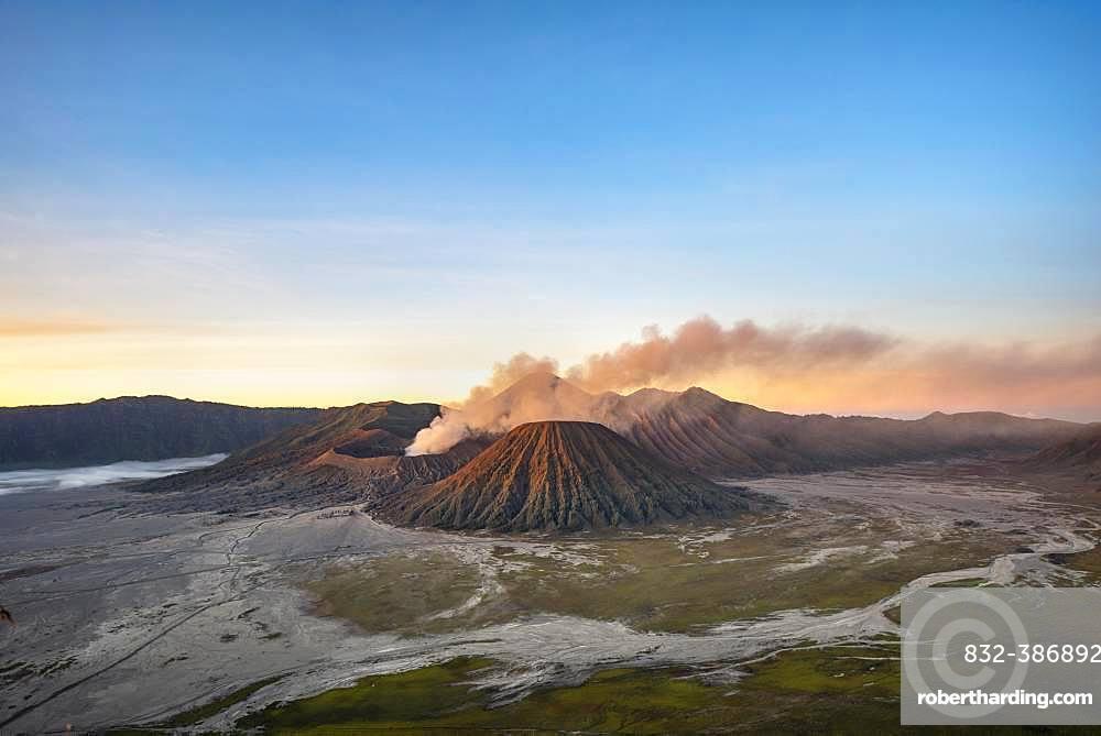 Volcanic landscape at sunrise, smoking volcano Gunung Bromo, with Mt. Batok, Mt. Kursi, Mt. Gunung Semeru, Bromo-Tengger-Semeru National Park, Java, Indonesia, Asia