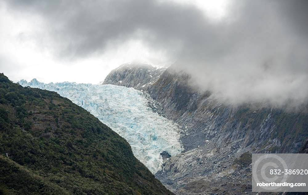 Tongue of Franz Josef Glacier, wrapped in clouds, West Coast, South Island, New Zealand, Oceania