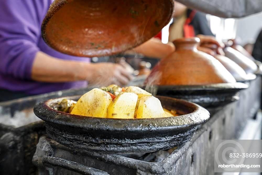 Delicious moroccan tajine prepared and served in clay pots, Marrakech