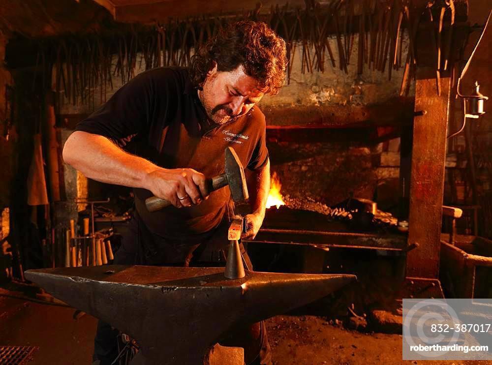 Blacksmith at the anvil, hammer mill Burghausen, Upper Bavaria, Bavaria, Germany, Europe