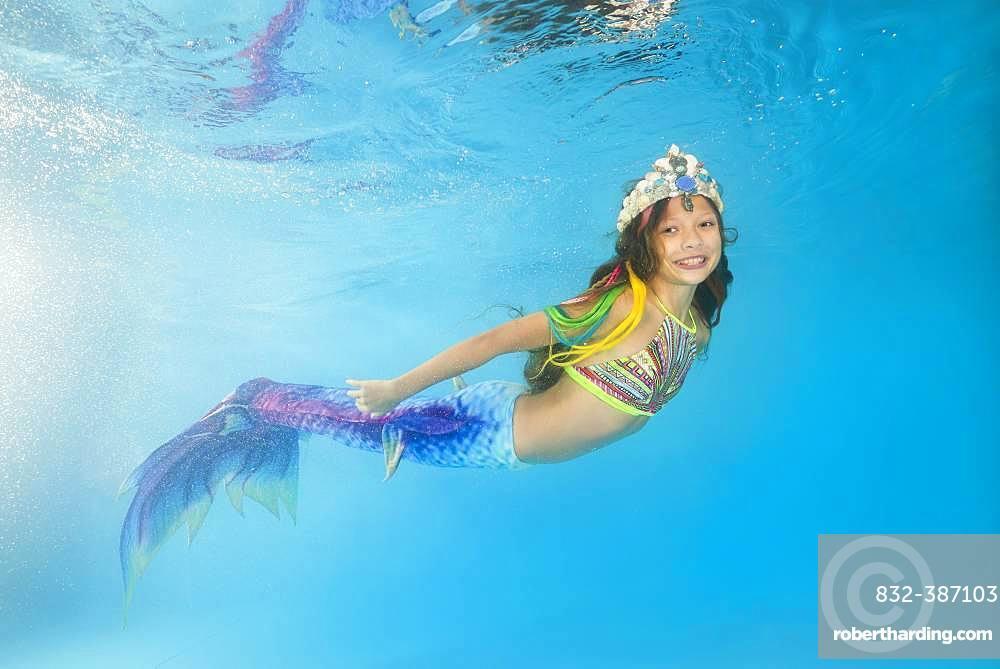 Girl in mermaid costume posing under water, Ukraine, Europe