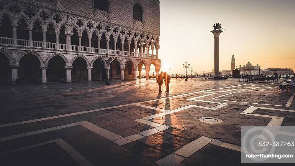 Sunrise with lovers at St Mark's Square, Venice, Italy, Europe