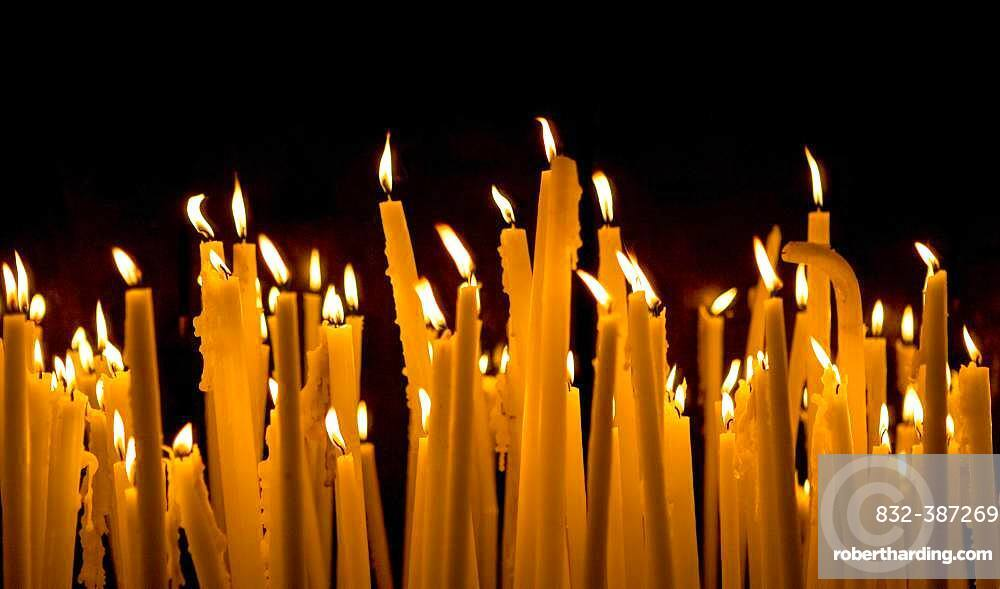 Ofer candles in the grotto, Lourdes, Department of Hautes Pyrenees, France, Europe