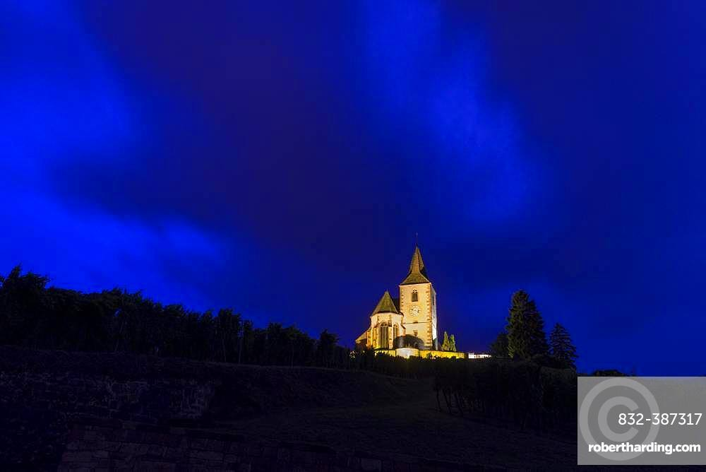 Thunderclouds over the church of Saint-Jaques-le-Majeur, Hunawihr, Haut-Rhin Department, France, Europe