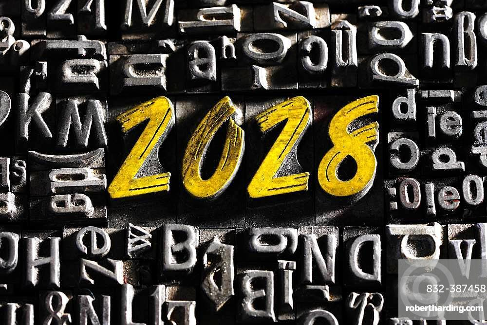 Old lead letters with golden writing show the word 2028, Germany, Europe