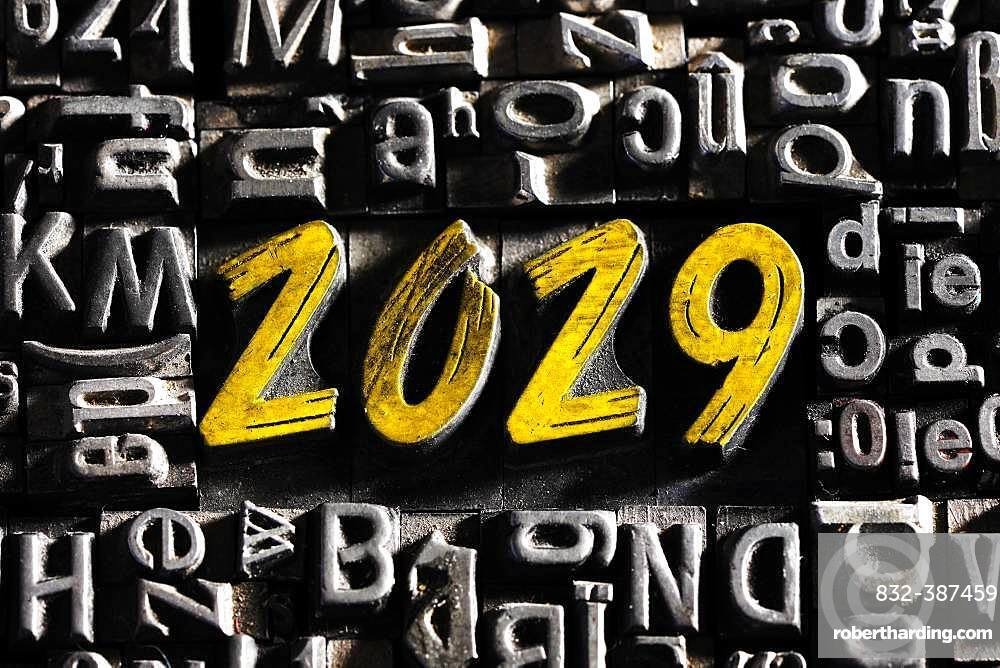 Old lead letters with golden writing show the word 2029, Germany, Europe