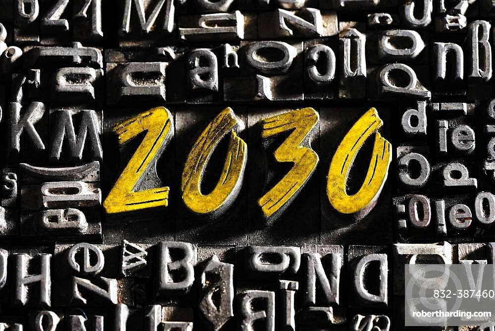 Old lead letters with golden writing show the word 2030, Germany, Europe