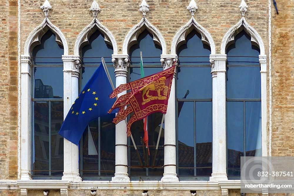 Waving flags of Europe and the Republic of Venice at Palazzo Zaguri, Venice, Venice, Italy, Europe