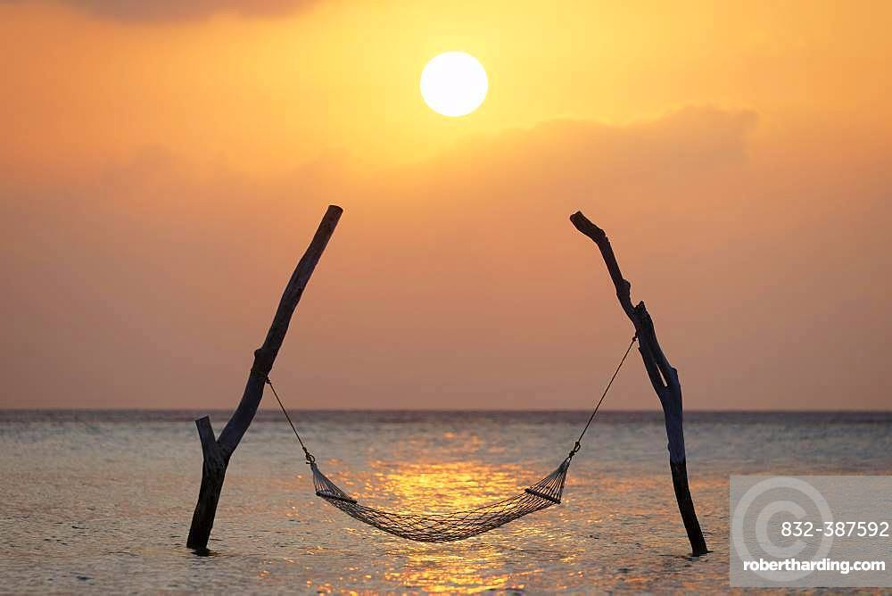 Sunset, Hammock on stilts over the sea, Indian Ocean, symbol for relaxation, recreation, vacation, Summer Island, North Male Atoll, Maldives, Asia