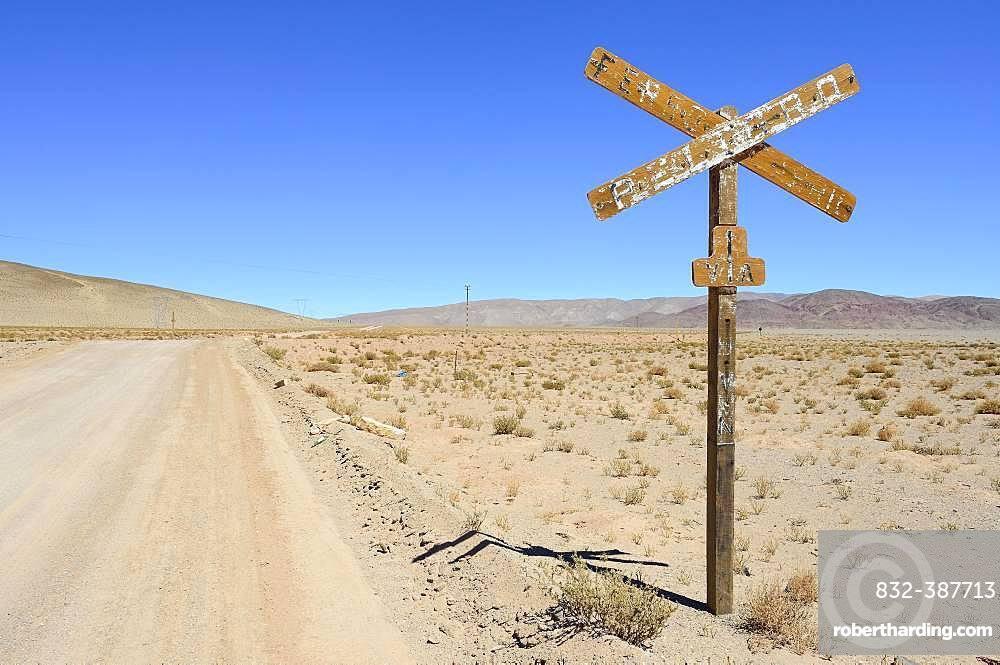 Weathered sign level crossing, Laguna Seca, Ruta 27, Puna, Salta Province, Argentina, South America